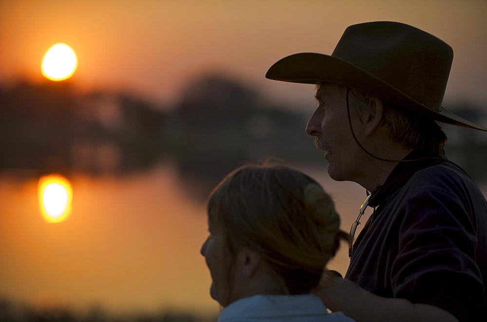 Couple at sundown in Botswana. - 857-54906