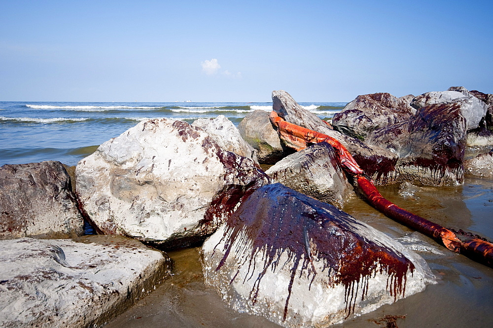 Oil splashed up over the jetty on Grand Isle State Park. The jetty along Barataria pass.
