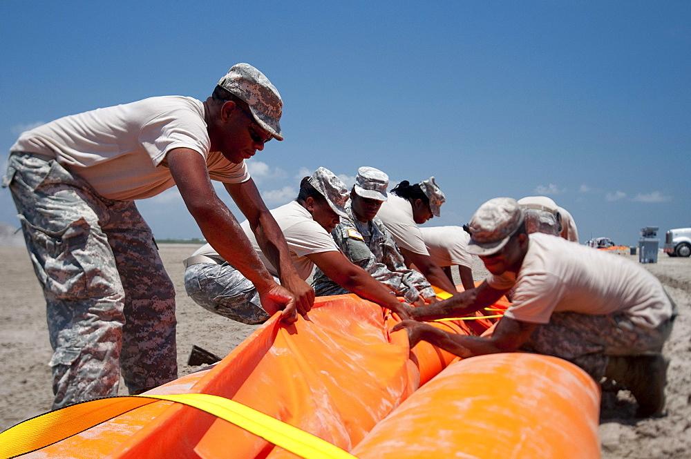 Preparing an oil boom on Elmers Island, LA.