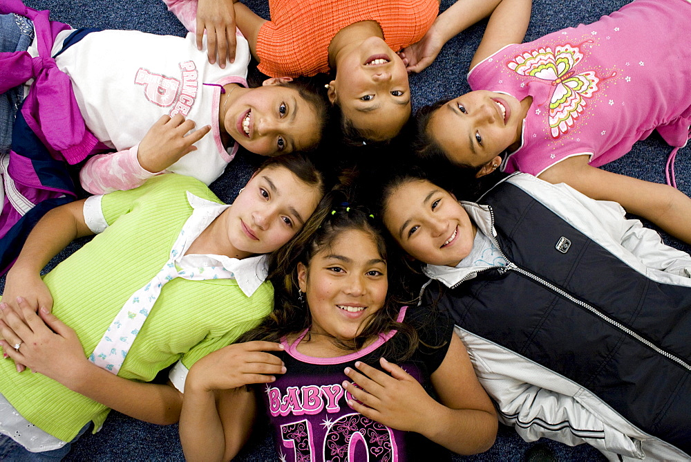 Palmira Gonzalez-Jiminez is surrounded by her best buddies at Harrington Elementary School in Denver, Colorado. A man tried to abduct Palmira in a nearby park last month. Her friends all ran to her aid hitting and kicking the man. The girls are clockwise