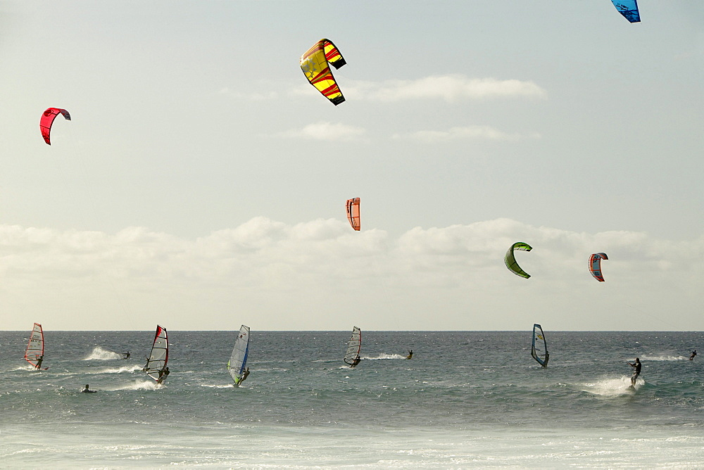 Kiteboarding, windsurfing, and surfing all on the same point break. Punta Preta (Black Point) on the island of Sal, Cape Verde.
