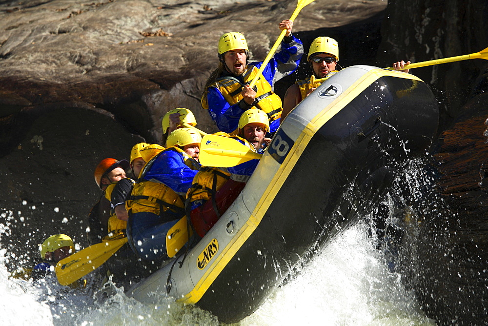 Unknown whitewater rafters crashing through Pillow Rock rapid on the Upper Gauley river near Fayetteville, WV