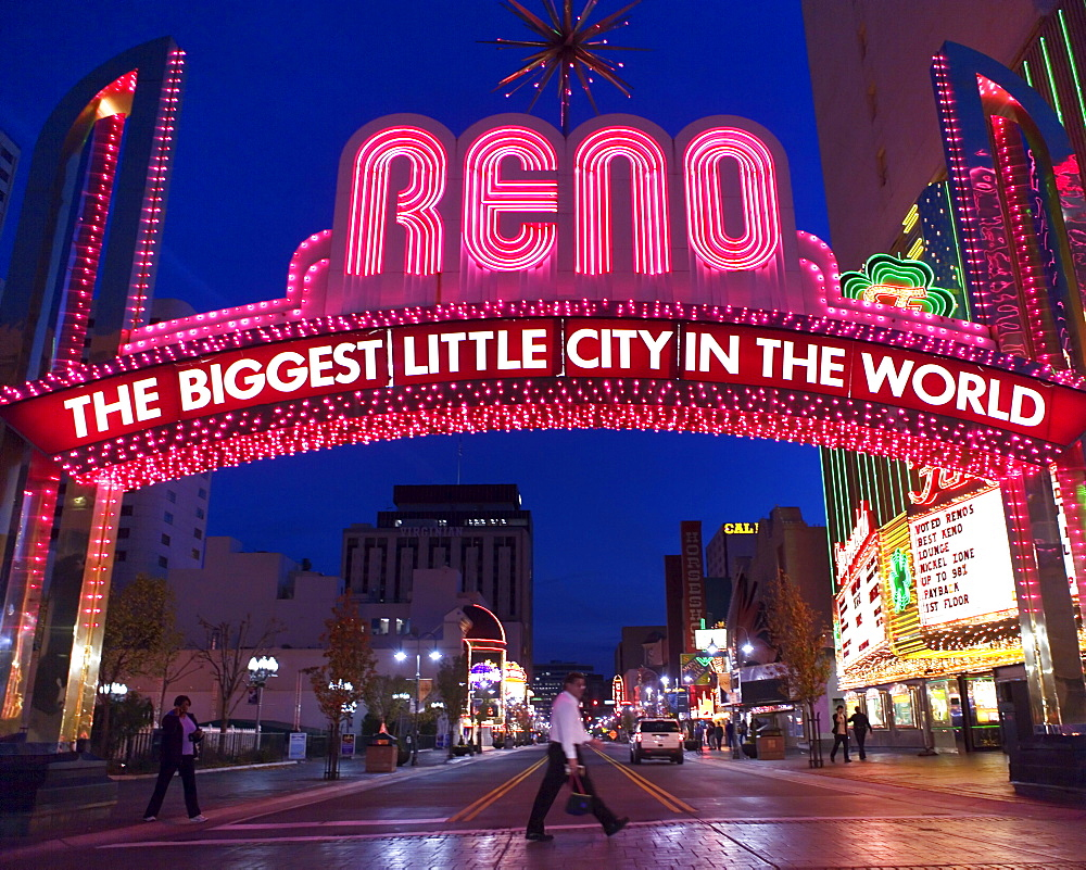 "Glittering icon archway advertising """"Reno - The Biggest Little City In the World"" at night, leading into the casino quarter in Reno, NV."
