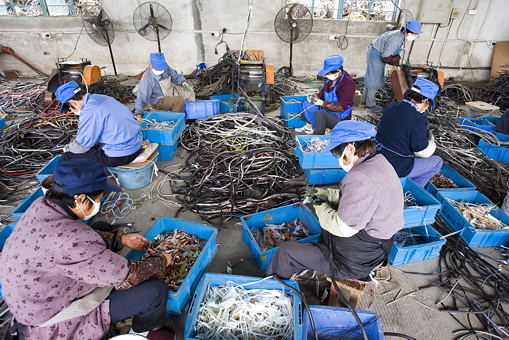 Taicang Port Imported Recyclable Resources Processing Zone, near Shanghai, China. This is a development project of the government to encourage business in recycling of metals and plastics, some of which comes from electronics. - 857-66644