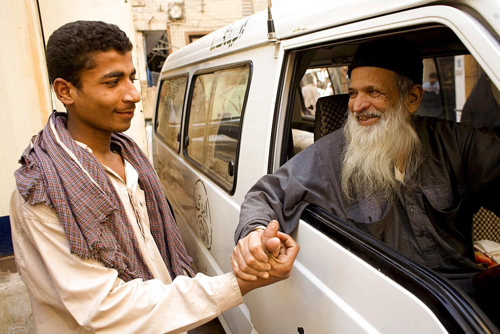 Pakistani do gooder Abdul Sattar Edhi greets a well wisher on February 1, 2008.