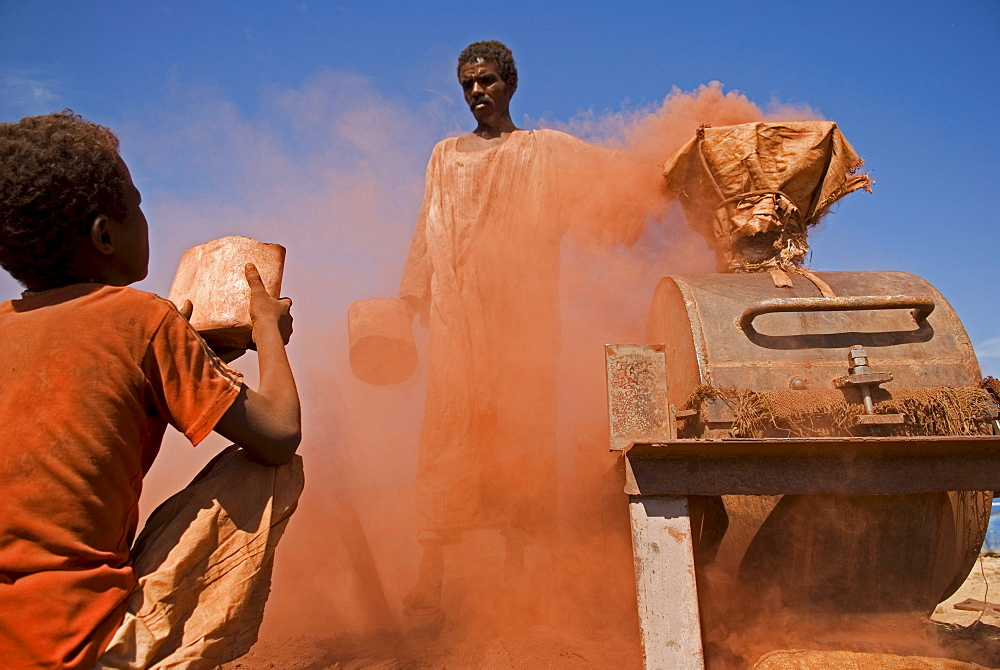 A boy helps crush stones in a special stone mill in Sudan. Illegal gold-mining in the region of the fourth cataract of the Nile in northern Sudan. People from the nearby villages work in shallow shafts in the desert. The rocks containing gold are crushed in a special mill. Some of the material is washed with water on the spot but the major part of it is taken to a village. 12/01/2007