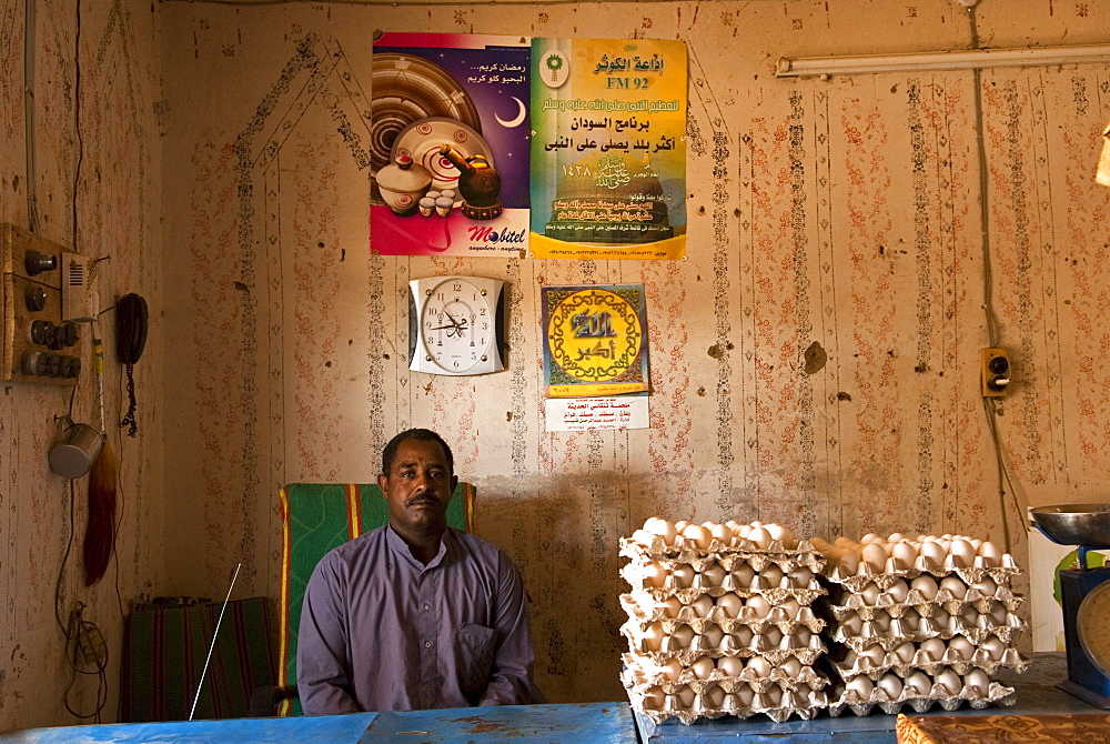 Shopkeeper sitting in his shop, northern Sudan.