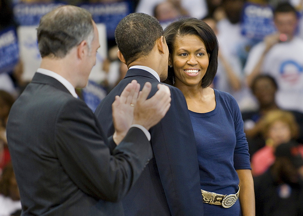 Senator Barack Obama whispers to his wife, Michelle Obama, while Senator Bob Casey watches at the Peterson Event Center in Pittsburgh, Pennsylvania, the night before the PA primary.