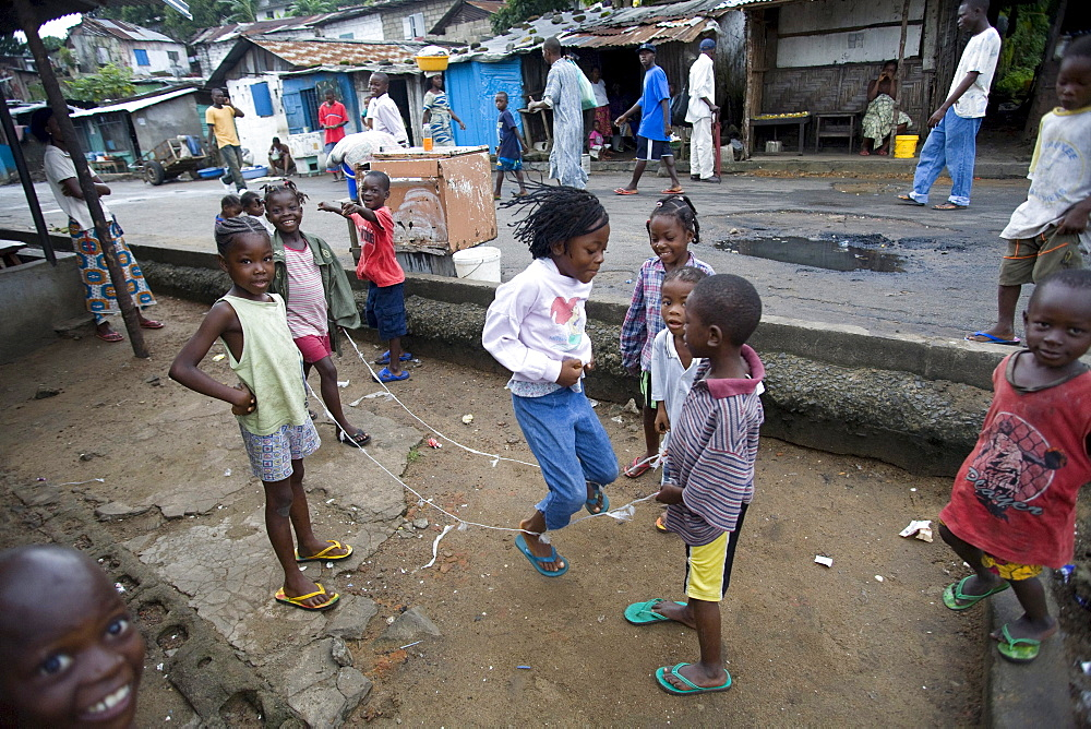 Monrovia, Liberia - September 18, 2007: Children skipping in the street in the fishing community of West Point in the Liberian Capital of Monrovia. The fishing industry is an important source of employment and food for Liberians and is increasingly under