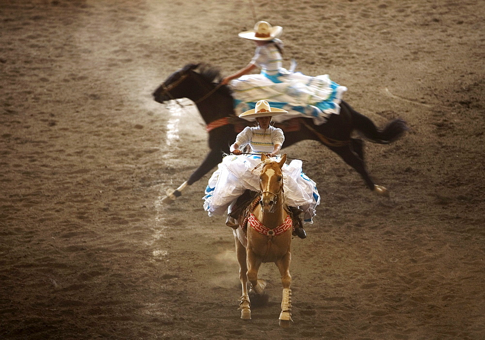 "Amazonas at an Escaramuza competition in Mexico City, May 24, 2008. Escaramuzas are similar to US rodeos, where female competitors called ""Amazonas"" wear long skirts, and ride side saddle. Male rodeo competitors are ""Charros,"" from which comes the word ""C"