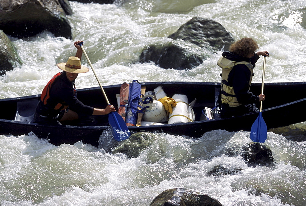 A canoe negotiates Lower Madison Falls rapid.