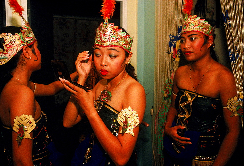 Javanese young women prepare for dance performance in Paramaribo, Suriname.