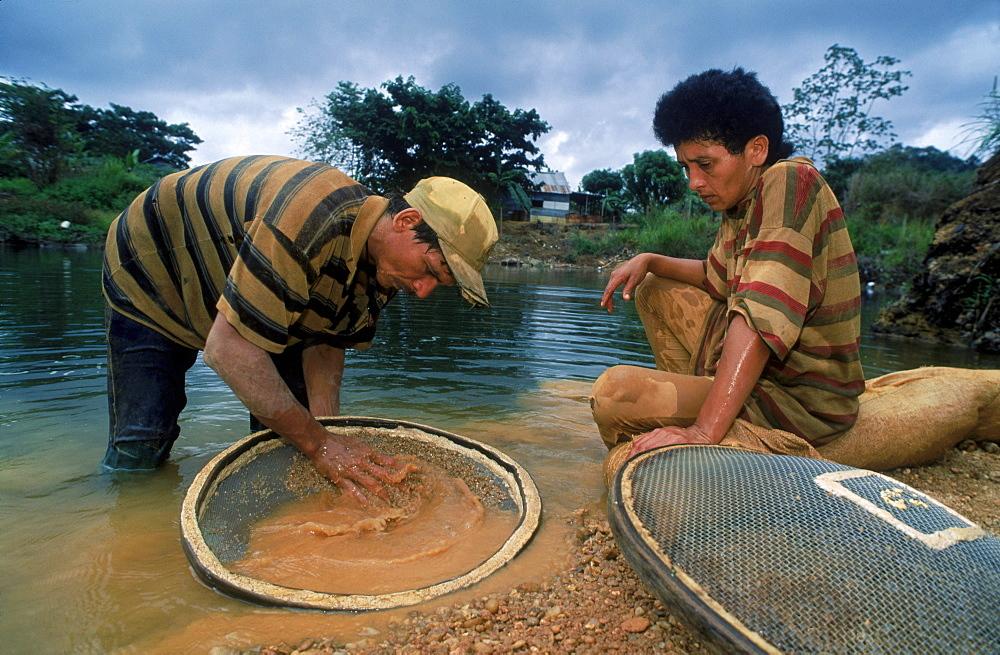 Diamond miners panning near Salvacion, Venezuela, South America.