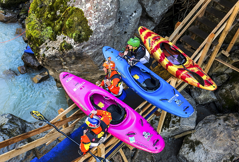the kayakers Dane Jackson (L-R, USA), Eric Jackson (USA) and Joe Morley (GBR) looking onto the Ötztaler Ache-River during the Adidas Sickline Extreme Kayaking World Championship 2014 in Oetz, Austria.