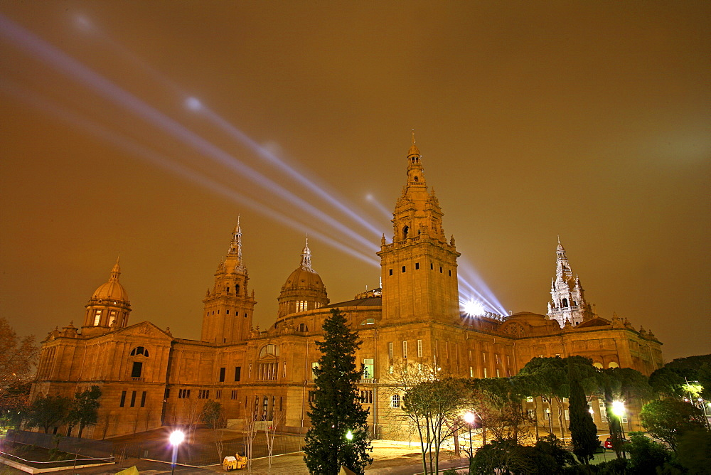 The National Art Museum of Catalonia, also known by its acronym MNAC, is illuminated at night in the city of Barcelona, Spain . Noted for its collection of Romanesque art, considered one of the most complete in the world.