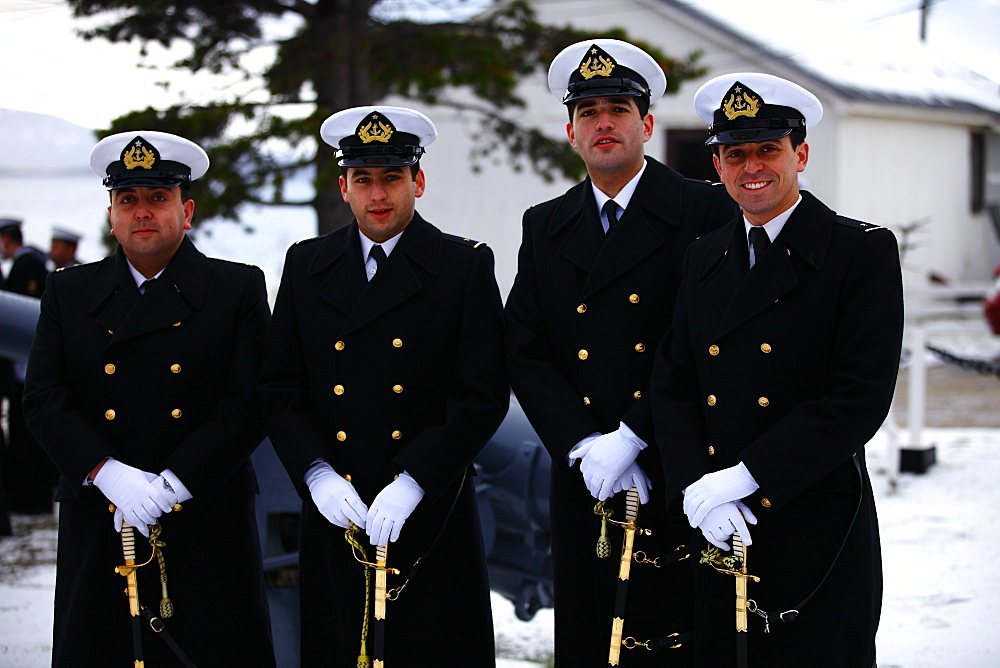 Navy officers stand in uniform in celebration of 21st of Mayo (Navy Day) in Puerto Williams, Isla Navarino - Chile.