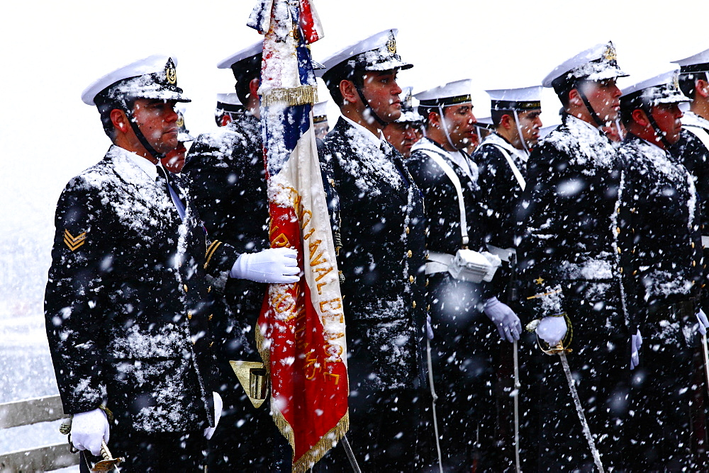 Chilean Navy officers stand in formation during a blizzard to celebrate 21st de Mayo (Navy Day) in Puerto Williams. Isla Navarino - Chile.