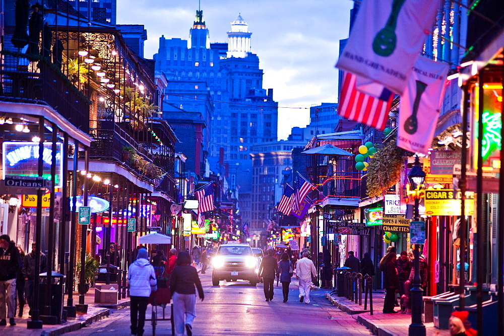 Bourbon Street lights up at dusk in New Orleans, Louisiana.