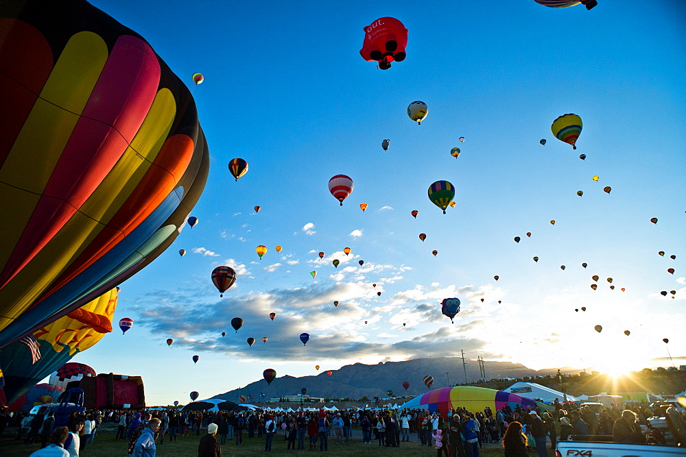 Hot air balloons fill the morning sky at the Hot Air Balloon Festival in Albuquerque, NM.