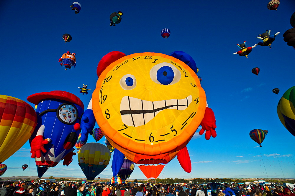 Colorful hot air balloons fill the sky at the Hot Air Balloon Festival in Alburque, NM.