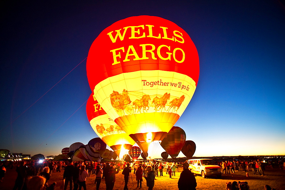 Hot air balloons light up at sunset during the Hot Air Balloon Festival in Albuquerque, NM.