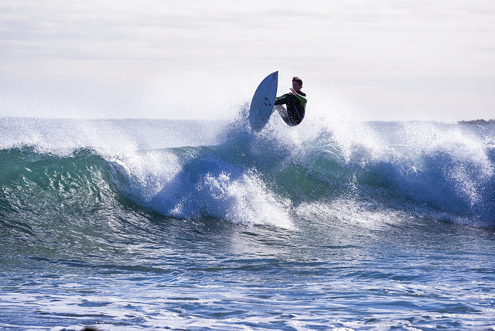 A surfer catching some air at Marrawah on Tasmania's rugged West Coast.