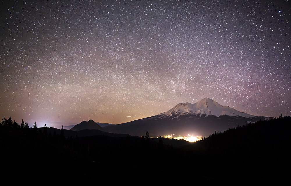 The Milky Way drifts over the city of Mount Shasta during a clear, winter night.
