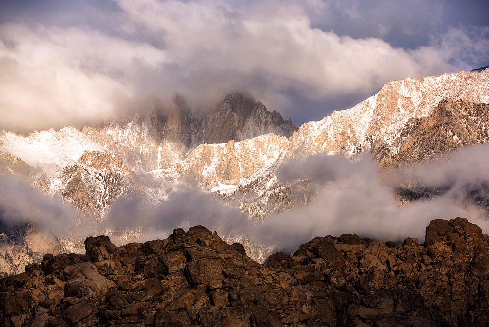 Dramatic clouds move in as a storm begins to cover Mount Whitney.