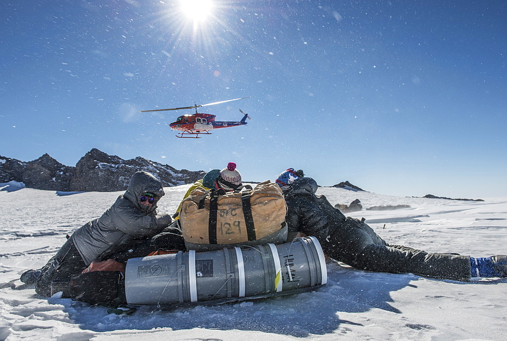 Sheltering from the rotor wash of a Bell 212 helicopter after being dropped off at 11,000ft on the slopes on Mount Erebus, Antarctica.