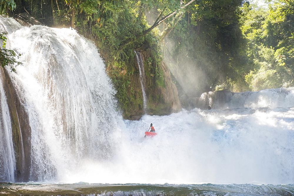 One man descending a waterfall in his kayak at Cascadas de Agua Azul, Chiapas, Mexico.