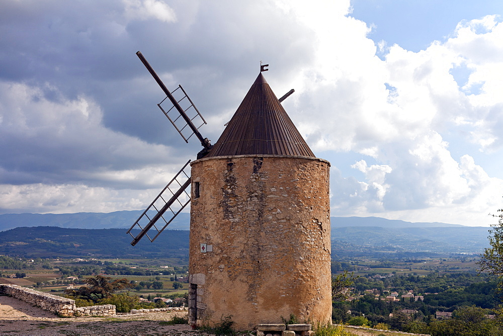 An old olive mill looks out over the hill village of St-Saturnin-les-Apt.