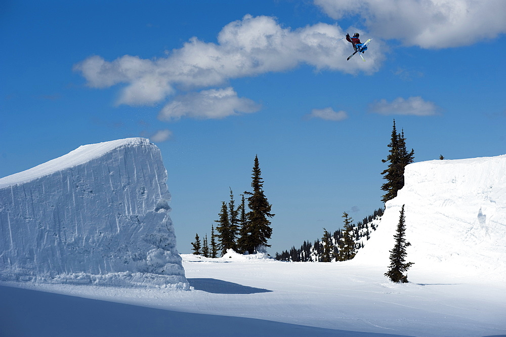 A snowboarder  clears a gap jump in British Columbia.