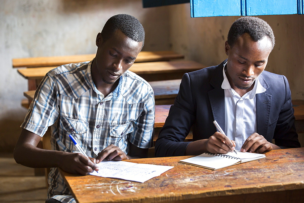 Students work on applications to a university at the Kiziba Refugee Camp in Kibuye, Rwanda.