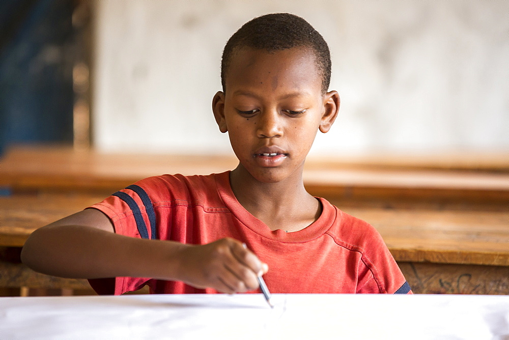 A student works on a project at the Kiziba Refugee Camp in Kibuye, Rwanda.