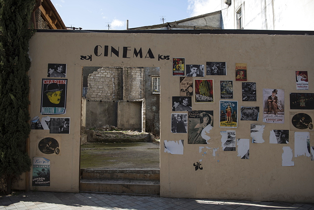 The remnants of a movie theater still donned with cinema posters sits in ruins in the old town district of Tbilisi, Republic of Georgia.
