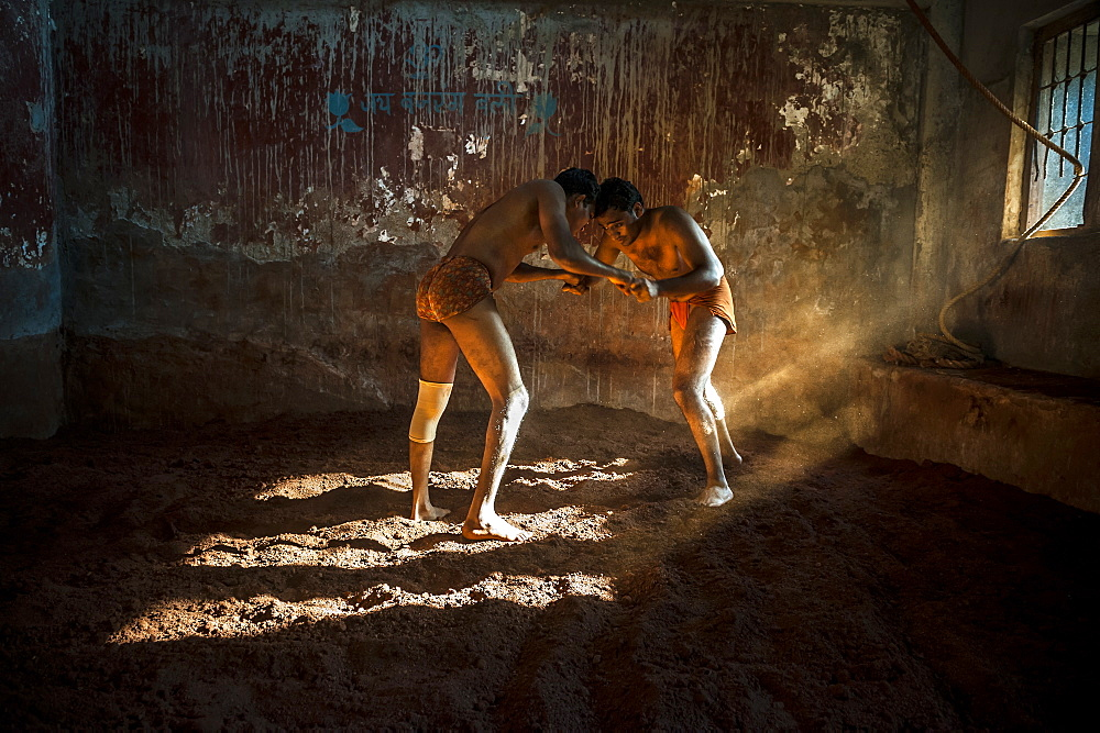 "Kushti is a traditional form of South Asian wrestling popular in India, also known as Pehlwani. Wrestlers usually meet in an Akhara, a ""wrestling ground"" which is a place of practice, with facilities for boarding, lodging and training.They serve both as training schools and an arena for wrestlers to compete against each other. Akhara is not limited only to physical activities, but also involves religious practices, particularly the worship of the god Hanuman. - 857-90543"