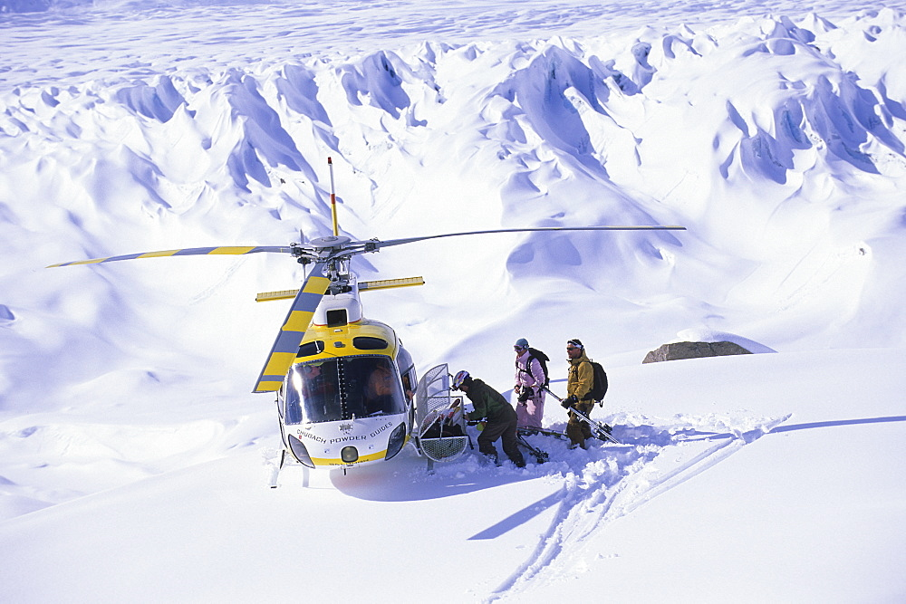 Group of skiers with CPG helicopter in the Tordrillo Mountains, Alaska, United States of America