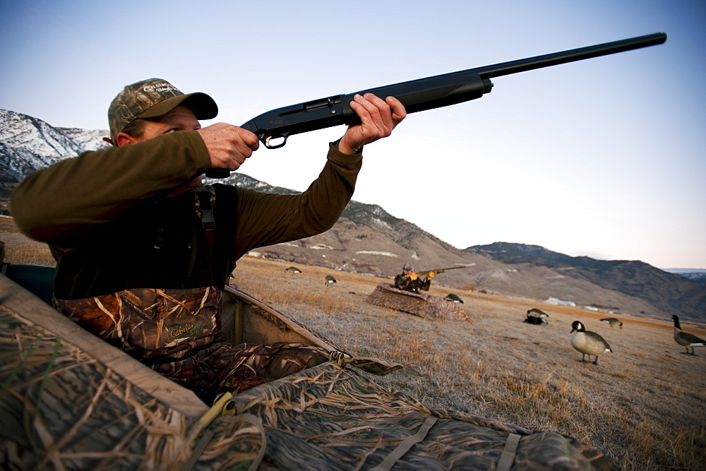 Brad Jackson and Corey Funk hunt geese from blinds in Carson City, NV, United States of America