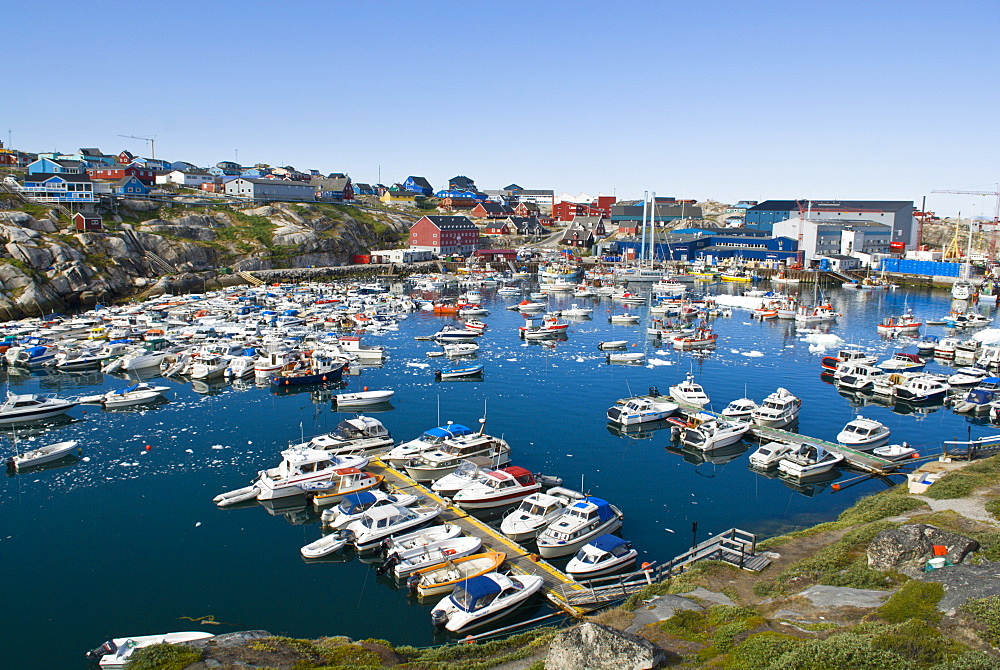 View of the natural harbour used as a boating marina, Ilulissat, Disko Bay, Greenland, on the 27 July 2008. The Ilulissat / Jacobshavn Glacier is regarded as the fastest calving glacier in the world, draining an estimated ten percent of the Greenland ice cap each year, Greenland