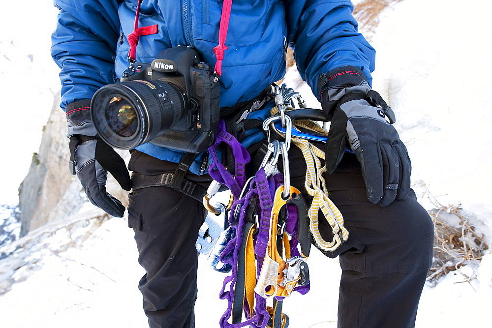 Corey Rich prepares his gear to photograph Zach Fletcher ice climbing in Lee Vining, CA, United States of America