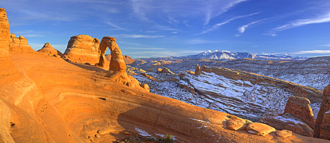 Delicate Arch glows as the sun sets over Arches National Park, Utah on December 26, 2006. The La Sal mountain range in the background has snowcapped peaks that tell of recent snowfall, United States of America