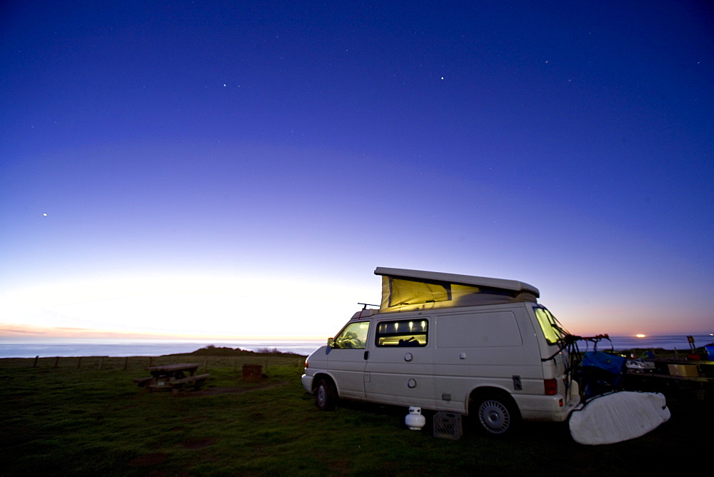 Camper van at twilight on the California coast, United States of America