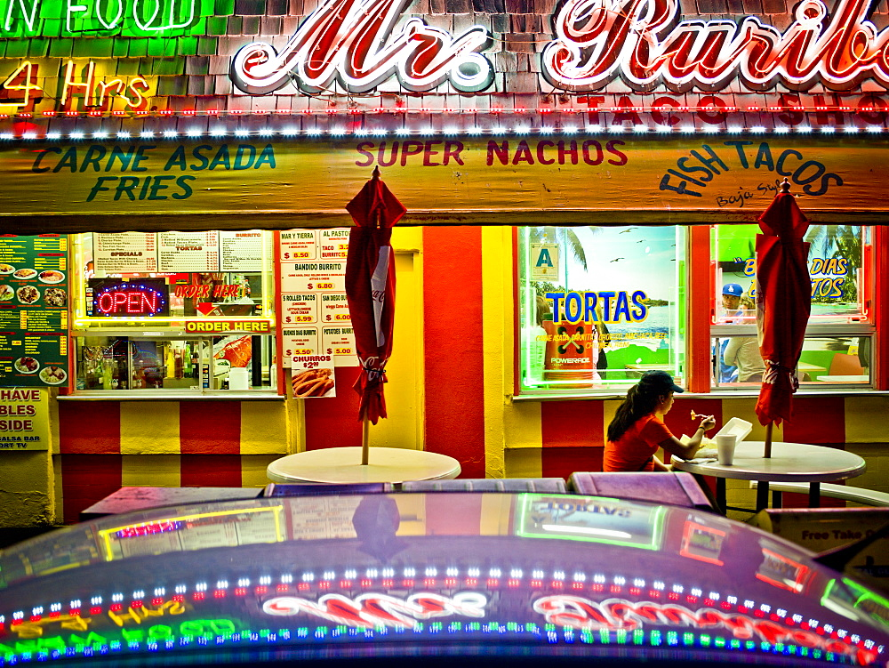 Colorful lights of a taco shop.