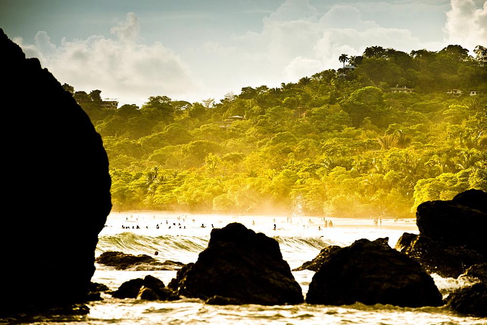 A rocky beach scene near sunset in Costa Rica.