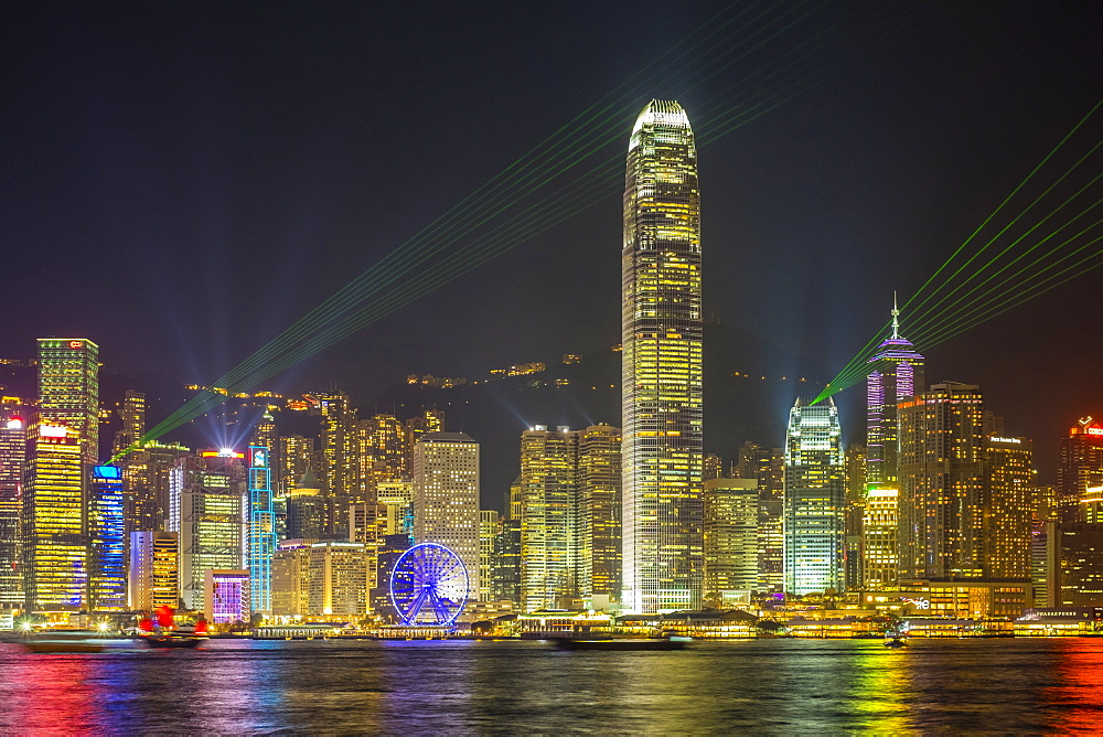 Skyscrapers on Hong Kong Island at night during 'A Symphony of Lights' laser light show