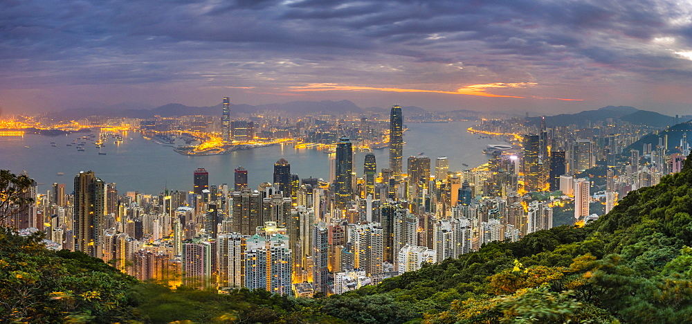 Panoramic view of Hong Kong skyline at dawn from Lugard Road on Victoria Peak