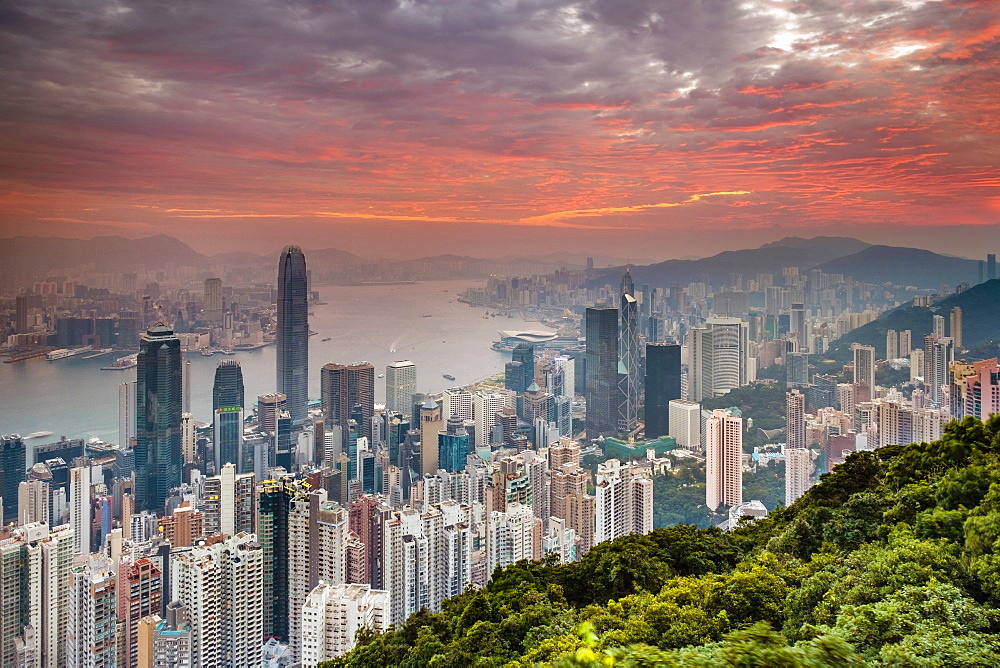 Hong Kong skyline at sunrise from Lugard Road on Victoria Peak