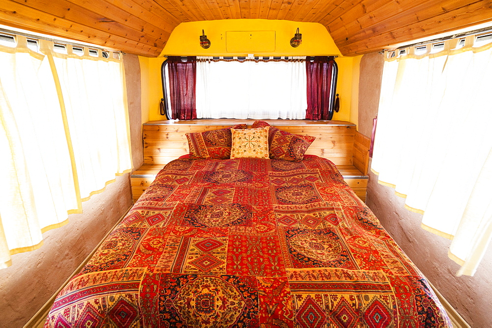 A bedroom in a city bus converted to a guest room at a bed and breakfast in Ezuz, Israel.
