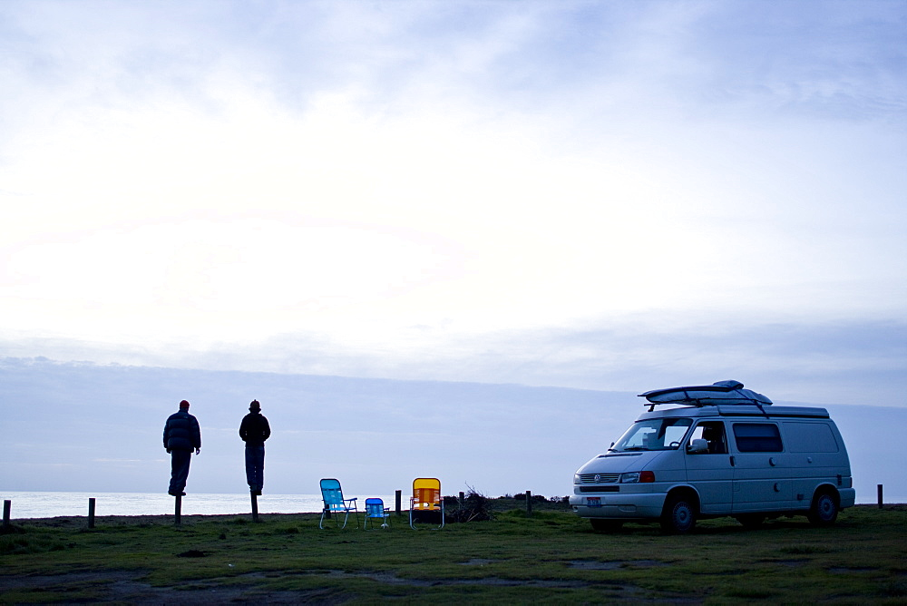 Friends van camping on the coast