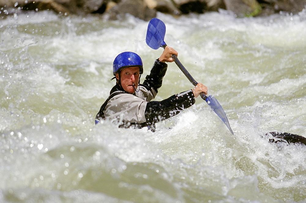 Kayaker navigating whitewater
